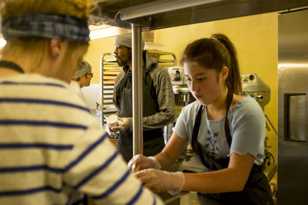 Brad Lumpkin and Maya Short work in the kitchen at SAME Cafe, East Colfax Avenue, Nov. 15, 2017. (Kevin J. Beaty/Denverite)  denver; colorado; denverite; kevinjbeaty; same cafe; food insecurity; colfax; city park west; food; restaurant;