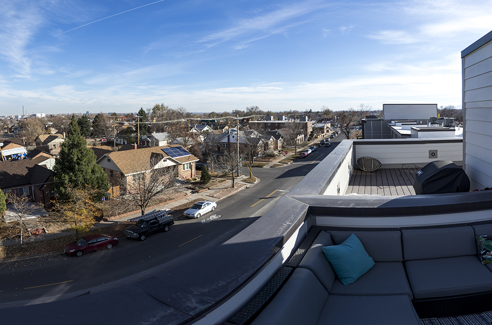 Rooftop decks above old West Colfax residences. Perry Row at Sloans Lake. Sloans Denver, Nov. 16, 2017. (Kevin J. Beaty/Denverite)  denver; colorado; denverite; kevinjbeaty; sloans lake; sloans denver; development; residential real estate;