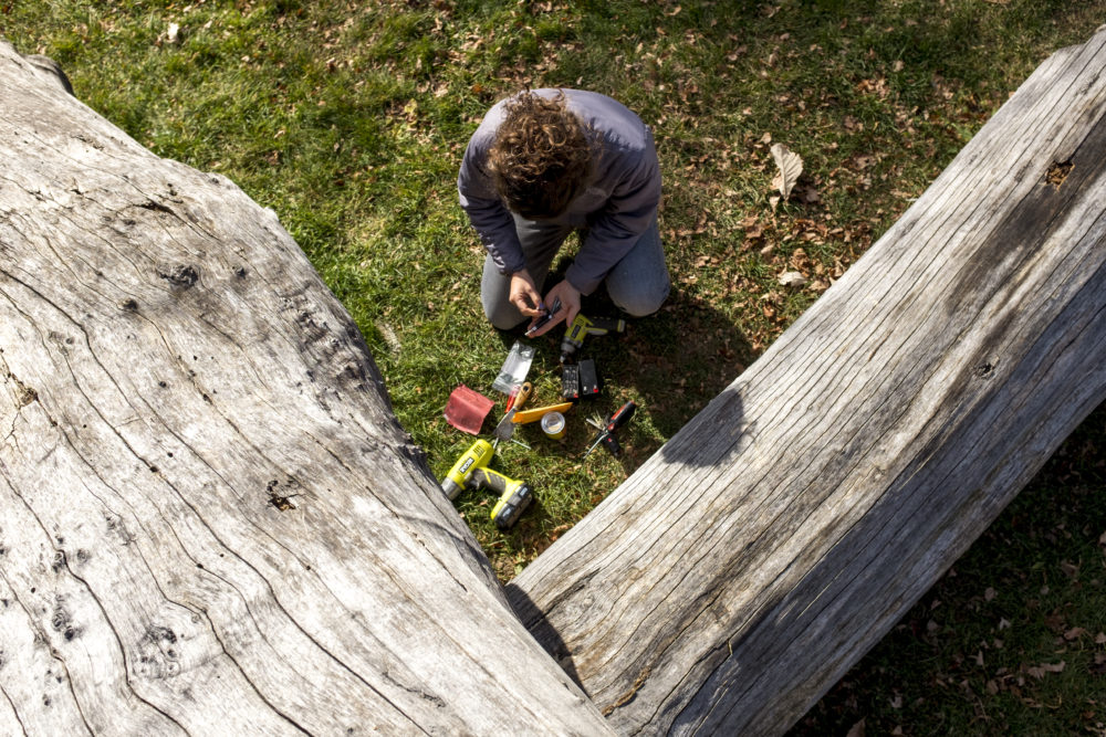 Nikki Pike works on a sound totem in Skyland's Boyd Park, Nov. 19, 2017. (Kevin J. Beaty/Denverite)  denver; colorado; sound totem; public art; denverite; kevinjbeaty; skyland;