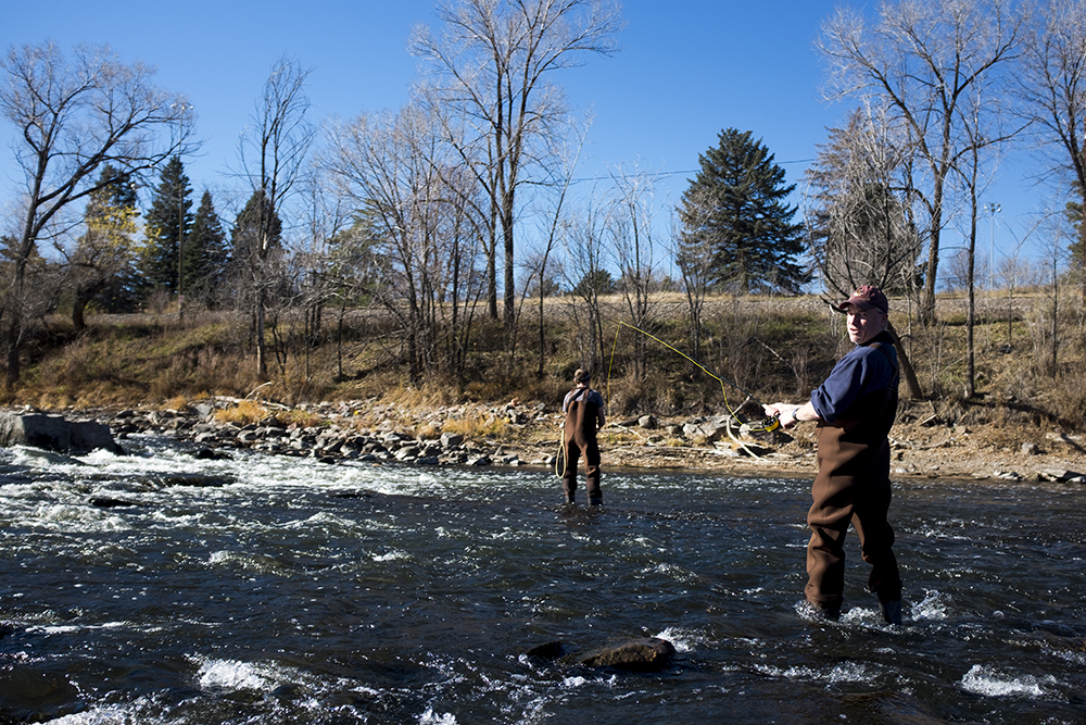Kevin Perry (right) and Doug Dupuie flyfish the South Platte River, Nov. 25, 2017. (Kevin J. Beaty/Denverite)