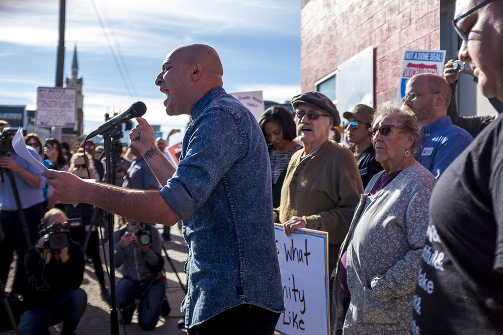 Bobby LeFebre recites a poem during a rally against Ink! Coffee in Five Points, Nov. 25, 2017. (Kevin J. Beaty/Denverite)