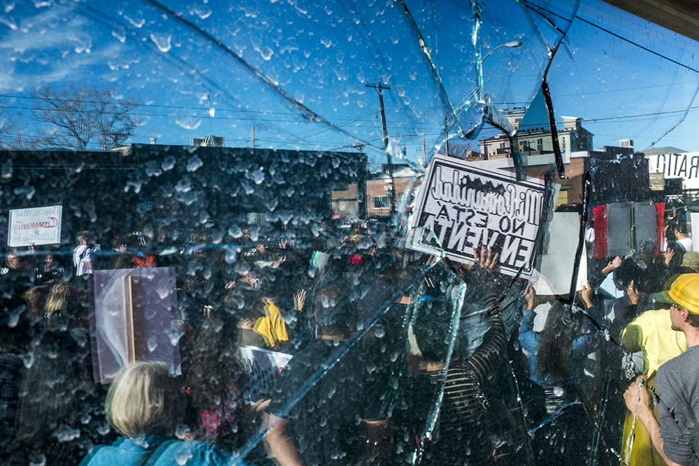 A broken window at Ink! Coffee in Five Points during a protest, Nov. 25, 2017. (Kevin J. Beaty/Denverite)  kevinjbeaty; denver; denverite; colorado; ink coffee; five points; rino; gentrification; protest;