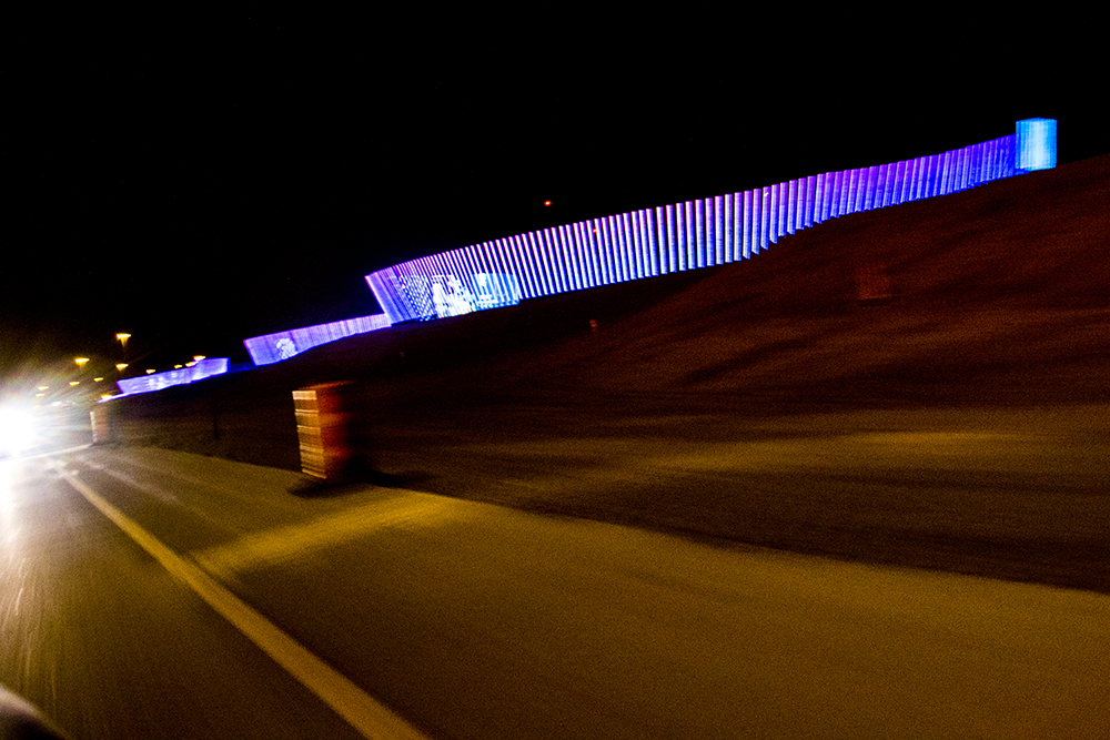 The new illuminated sign at Denver International Airport, Nov. 27, 2017. (Kevin J. Beaty/Denverite)  kevinjbeaty; denver; denverite; colorado; night; twilight; dia; denver international airport; public art;