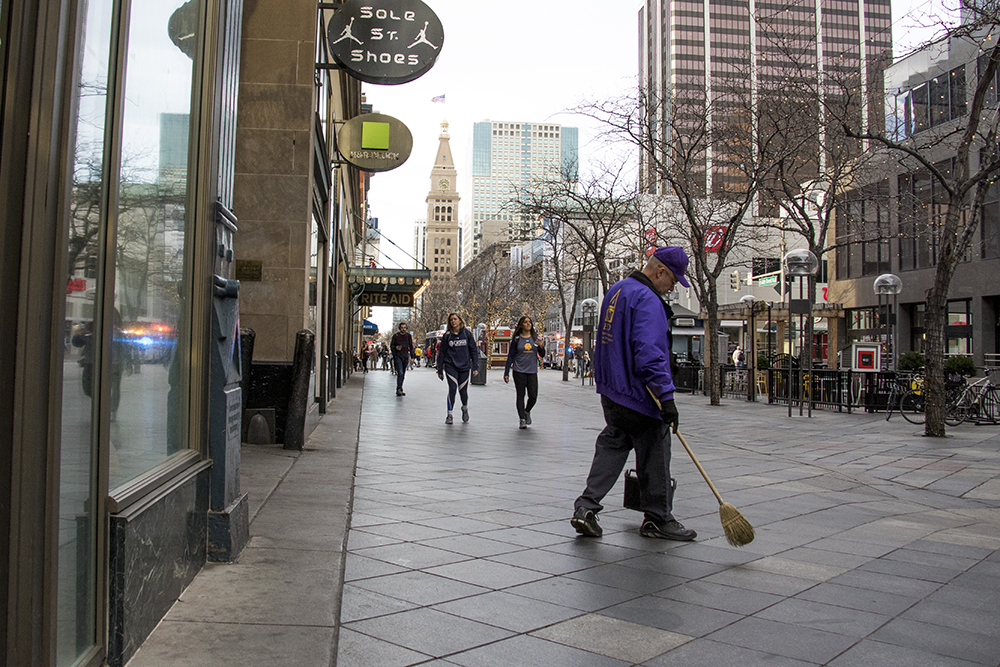 A member of the Downtown Denver BID's Clean Team at work on the 16th Street Mall, Nov. 29, 2017. (Kevin J. Beaty/Denverite)