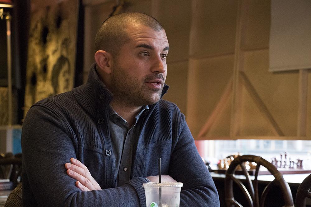Kayvan Khalatbari speaks with a reporter at Mutiny Information Cafe, Nov. 29, 2017. (Kevin J. Beaty/Denverite)