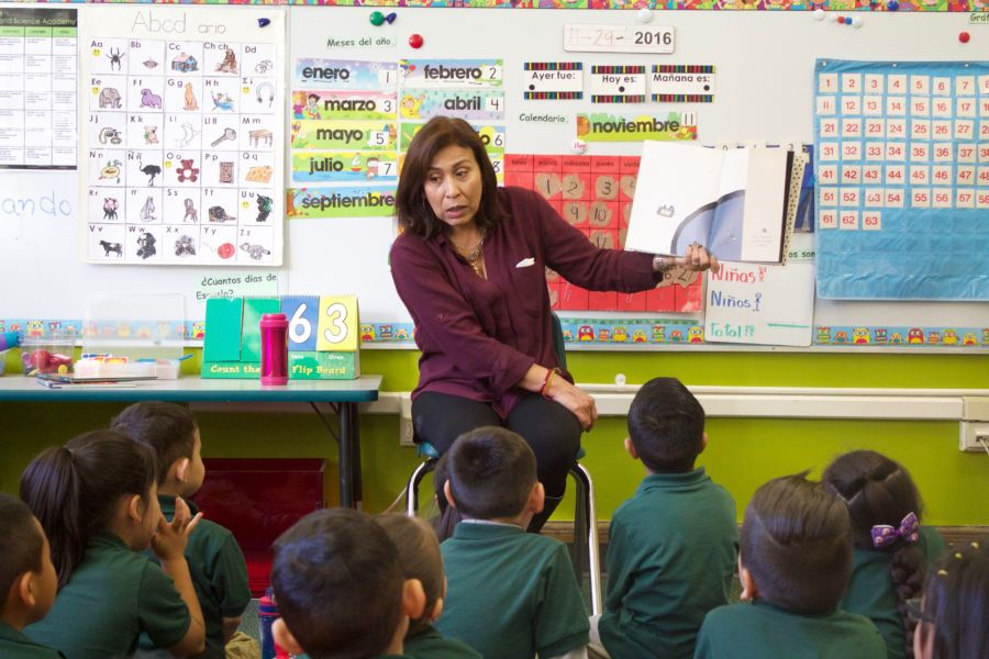 A teacher reads to her students at the Cole Arts and Science Academy in Denver. (Photo by Nic Garcia/Chalkbeat)