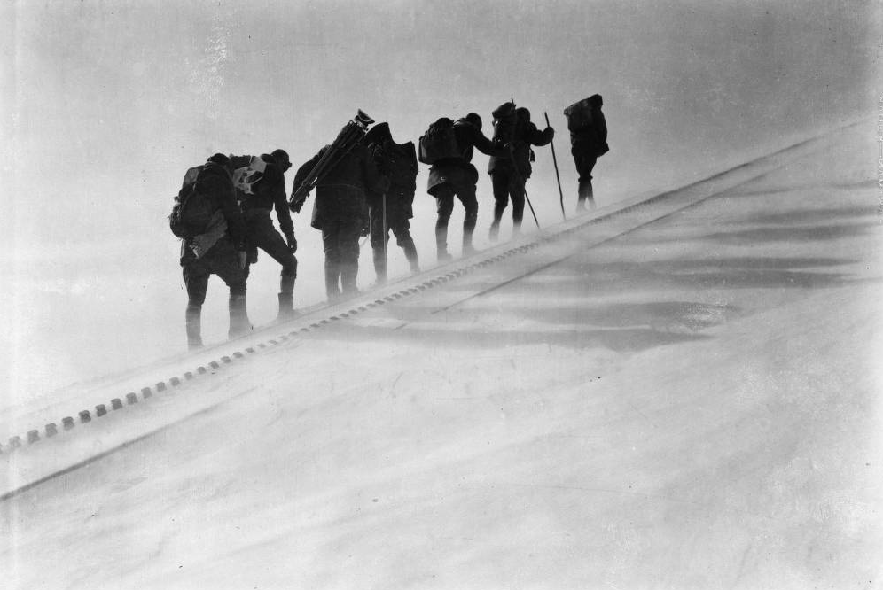 Members of the AdAmAn Club climb the Pikes Peak Cog Railway tracks on New Year's Eve to set off fireworks sometime between 1922 and 1941. (Harry L. Standley/Western History & Genealogy Dept./Denver Public Library)
