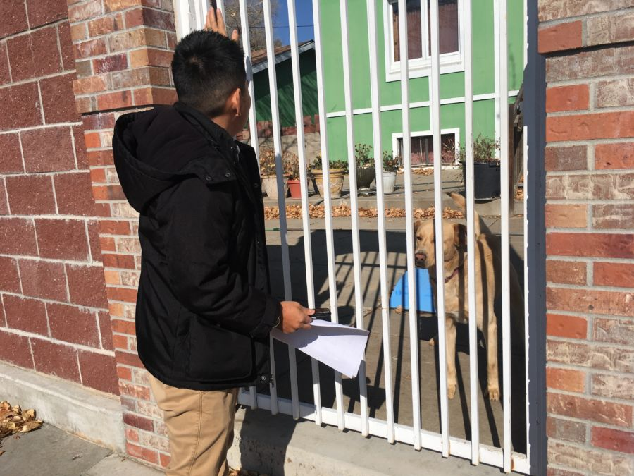 Bonifacio Sanchez Flores, a social worker at Grant Beacon Middle School, visits the home of a student who didn't come to school on Halloween. (Ann Schimke/Chalkbeat)