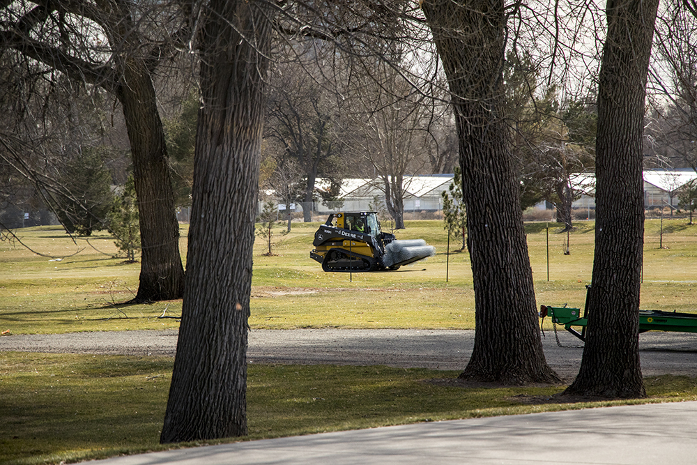 Construction has begun at City Park Golf Course and here's a bulldozer carrying a lot of chain-link fencing, Dec. 4, 2017. (Kevin J. Beaty/Denverite)