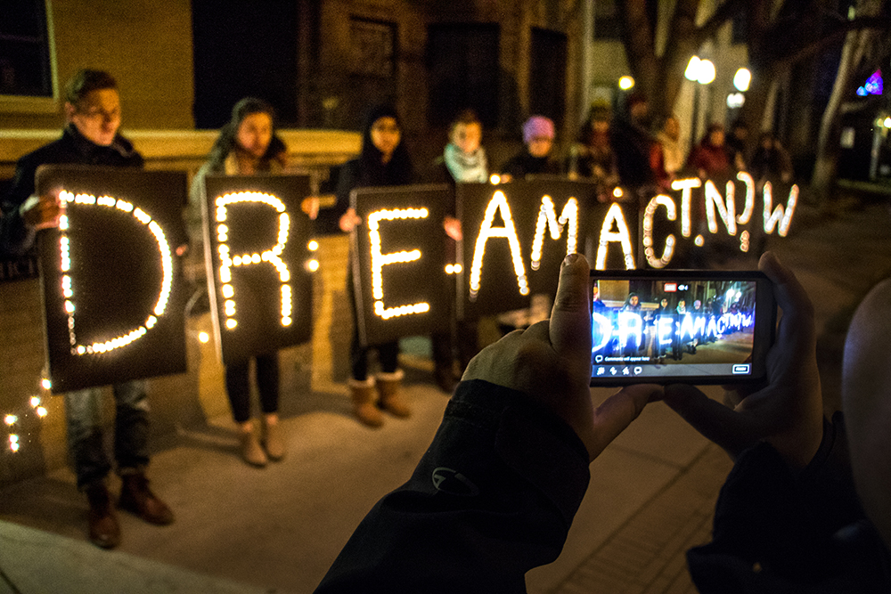 "The Colorado Immigrants Rights Coalition holds a short vigil outside Senator Michael Bennet's office in Capitol Hill asking for a ""clean"" DREAM Act bill, Dec. 8, 2017. (Kevin J. Beaty/Denverite)  denver; colorado; immigration; protest; daca; circ; colorado immigrants rights coalition; denverite; capitol hill;"