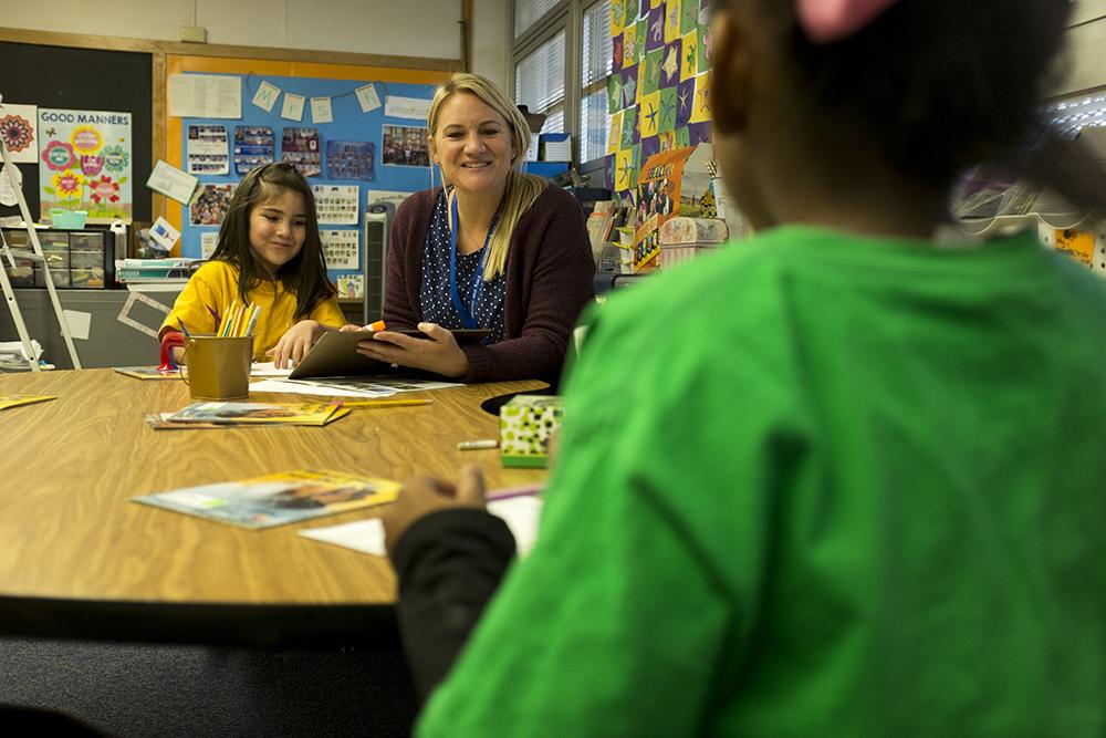 First grade teacher Allison Kresinski teaches reading at Goldrick Elementary School, Dec. 7, 2017. (Kevin J. Beaty/Denverite)  denver; colorado; denverite; kevinjbeaty; elementary school; education; goldrick elementary; learning; classroom;