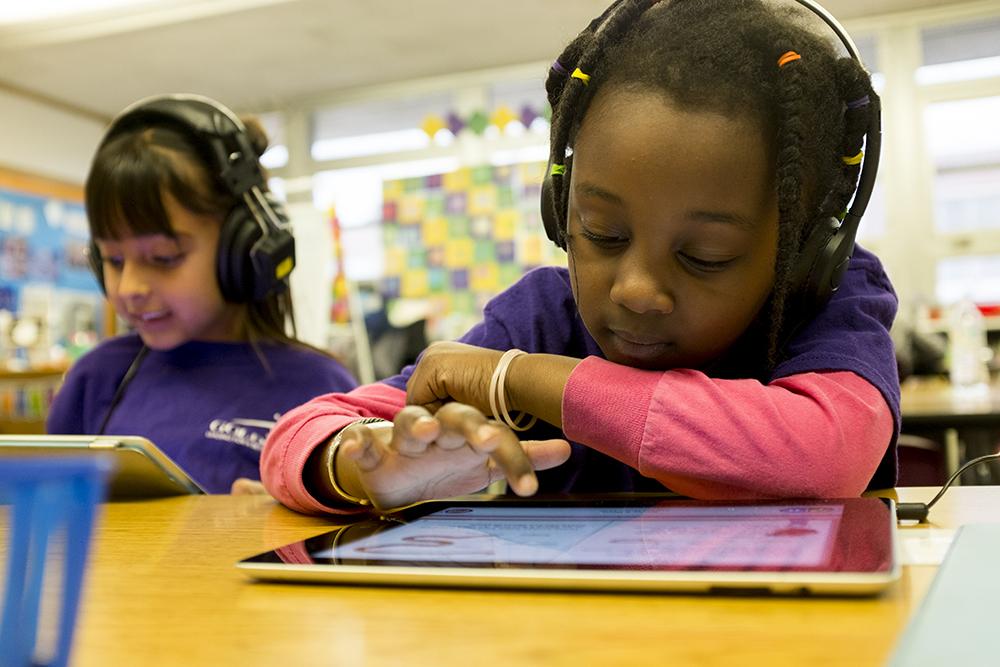 First graders learn on iPads at Goldrick Elementary School, Dec. 7, 2017. (Kevin J. Beaty/Denverite)