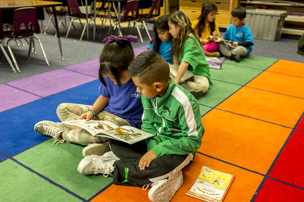First graders read in a bilingual classroom at Goldrick Elementary School, Dec. 7, 2017. (Kevin J. Beaty/Denverite)  denver; colorado; denverite; kevinjbeaty; elementary school; education; goldrick elementary; learning; classroom;