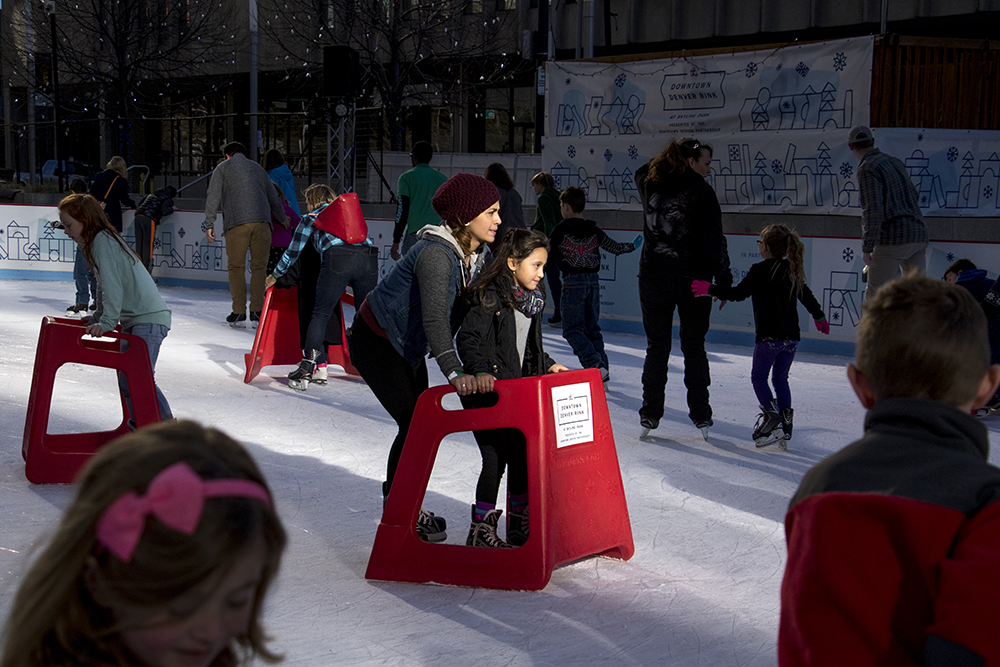 Silvia Rascon skates with her daughter, Jasaidi, on a sunny Saturday at Skyline Park, Dec. 10, 2017. (Kevin J. Beaty/Denverite)
