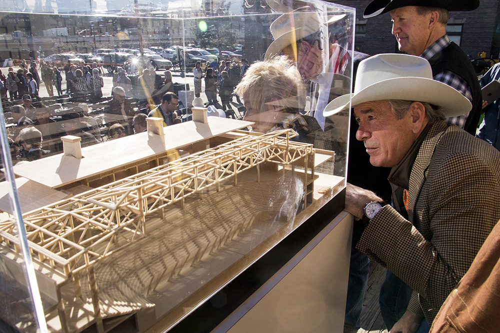 Doug Jones peers into the new model unveiled for the National Western Center, Dec. 12, 2017. (Kevin J. Beaty/Denverite)