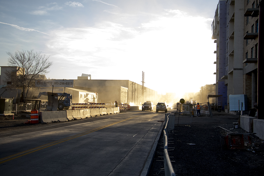 A dusty cloud from a Brighton Boulevard construction site is illuminated by late-afternoon sunlight. Dec. 12, 2017. (Kevin J. Beaty/Denverite)  rino; five points; brighton boulevard; kevinjbeaty; denver; denverite; colorado;