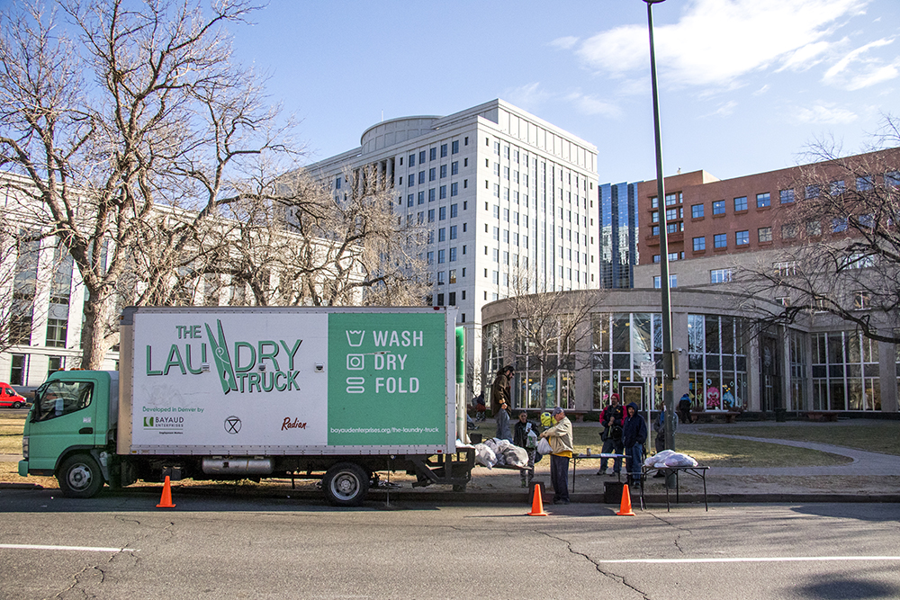 The Laundry Truck at work at the Denver Public Library downtown, Dec. 13, 2017. (Kevin J. Beaty/Denverite)  denver; colorado; denverite; kevinjbeaty; homeless; laundry truck; bayaud enterprises; library building; dplbroadway;