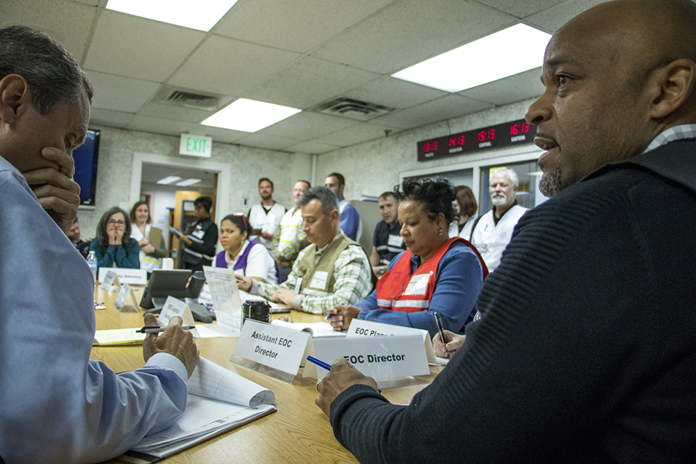 Mayor Michael Hancock runs the mock emergency as he would in the event of a real situation. The Denver Office of Emergency Management practices a worst-case security scenario in their basement offices in the City and County Building, Dec. 15, 2017. (Kevin J. Beaty/Denverite)