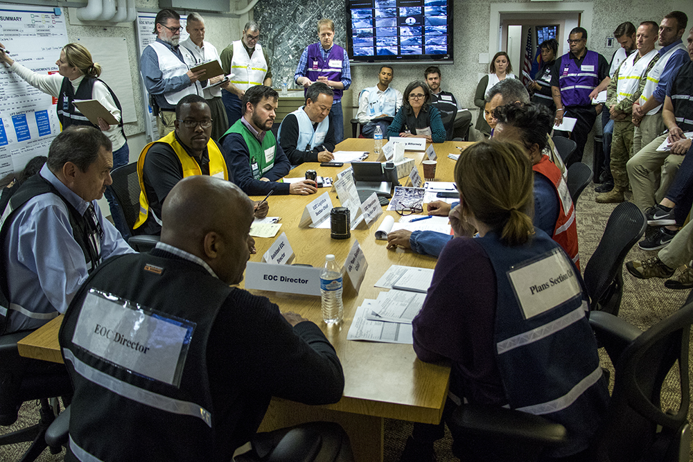 Mayor Michael Hancock runs the mock emergency as he would in the event of a real situation. The Denver Office of Emergency Management practices a worst-case security scenario in their basement offices in the City and County Building, Dec. 15, 2017. (Kevin J. Beaty/Denverite)  city and county building; oem; Office of Emergency Management; colorado; denver; denverite; kevinjbeaty;