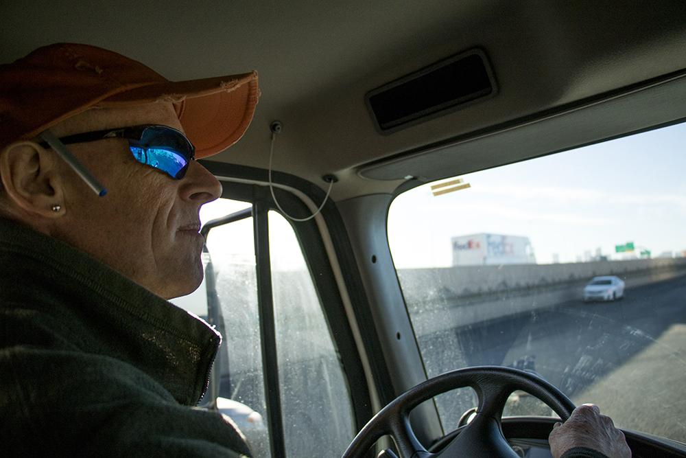Tim Sanford pilots one of We Don't Waste's trucks, Dec. 18, 2017 (Kevin J. Beaty/Denverite)  denver; colorado; denverite; food insecurity; food; sustainability;