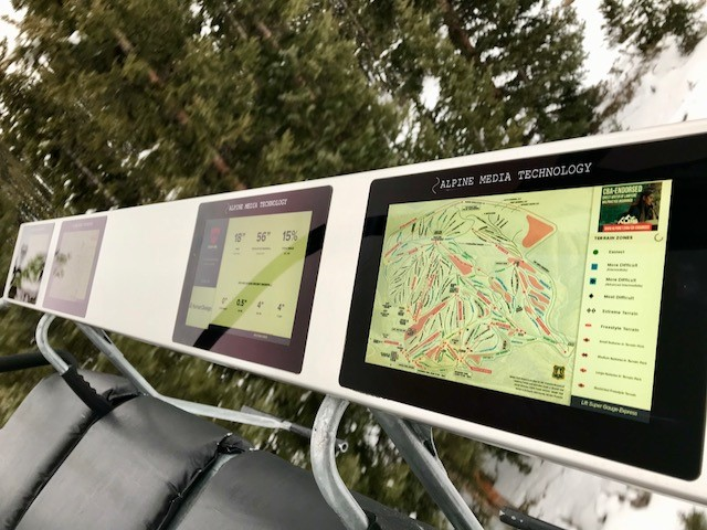 Screens on a chairlift. (Courtesy Winter Park)