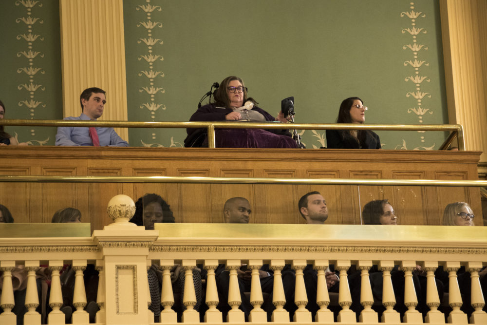 ADAPT disabilities rights activist Carrie Ann Lucas listens in to Governor John Hickenlooper's State of the State address, Jan. 11, 2017. (Kevin J. Beaty/Denverite)  copolitics; governor john hickenlooper; denver; colorado; denverite; kevinjbeaty;