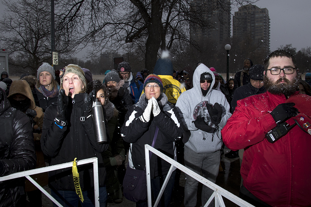 The audience cheers after the National Anthem was sung. The Martin Luther King Jr. Day Marade, Jan. 15, 2018. (Kevin J. Beaty/Denverite)  mlk; martin luther king jr; marade; parade; march; denver; colorado; denverite; protest; city park;
