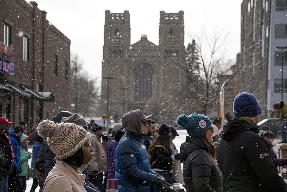 The Martin Luther King Jr. Day Marade processes down Colfax Avenue, Jan. 15, 2018. (Kevin J. Beaty/Denverite)  mlk; martin luther king jr; marade; parade; march; colfax; denver; colorado; denverite; protest;