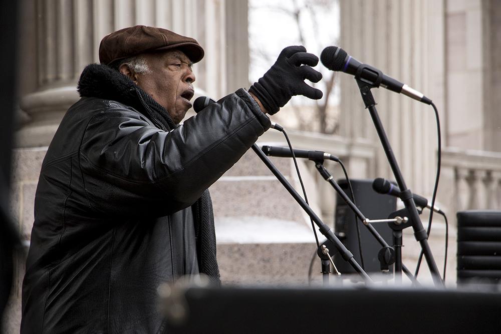 Bishop Acen Phillips speaks at Civic Center Park. The Martin Luther King Jr. Day Marade, Jan. 15, 2018. (Kevin J. Beaty/Denverite)  mlk; martin luther king jr; marade; parade; march; colfax; denver; colorado; denverite; protest; civic center park;