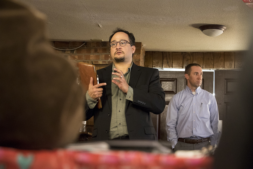 City Councilman Raphael Espinoza addresses the crowd. A meeting informing Golden Manor residents on details for the assisted living facility's closure in three months, Jan. 25, 2018. (Kevin J. Beaty/Denverite)  assited living; aging; affordable housing; housing; elder care; denver; denverite; west colfax; kevinjbeaty;