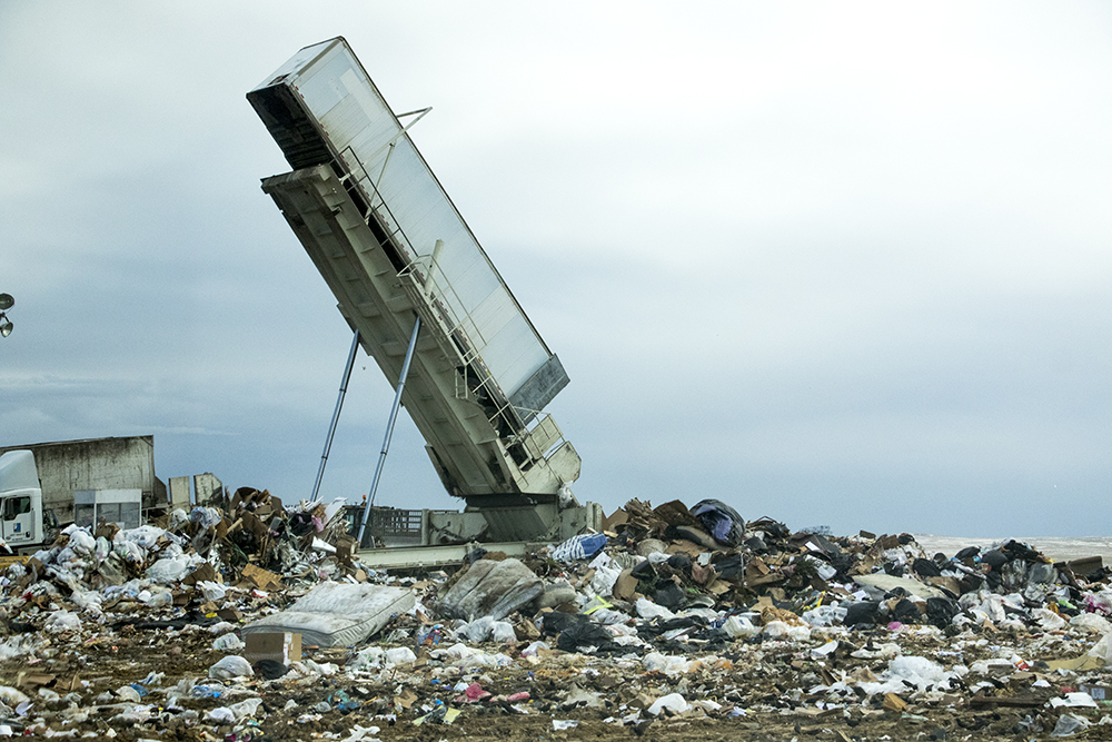 A truck is inverted atop the active dumping site. Denver Arapahoe Disposal Site, the landfill owned by Denver and operated by Waste Management. Jan. 26, 2018. (Kevin J. Beaty/Denverite)