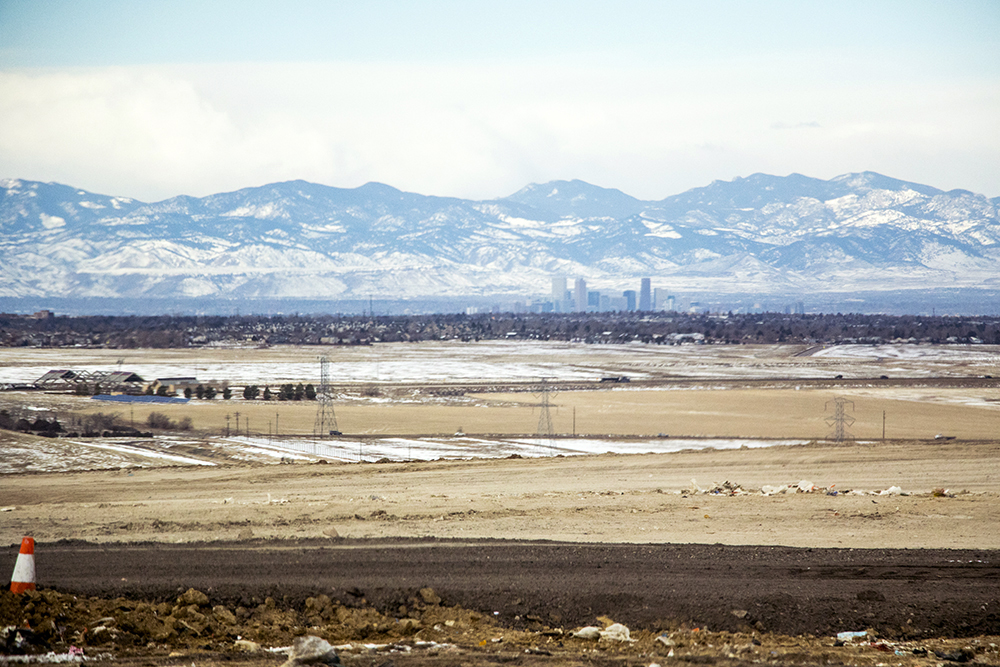 The city skyline seen from atop the Denver Arapahoe Disposal Site, the landfill owned by Denver and operated by Waste Management. Jan. 26, 2018. (Kevin J. Beaty/Denverite)  waste management; garbage; environment; trash; dump; landfill; denverite; kevinjbeaty; colorado; aurora; skyline; cityscape;