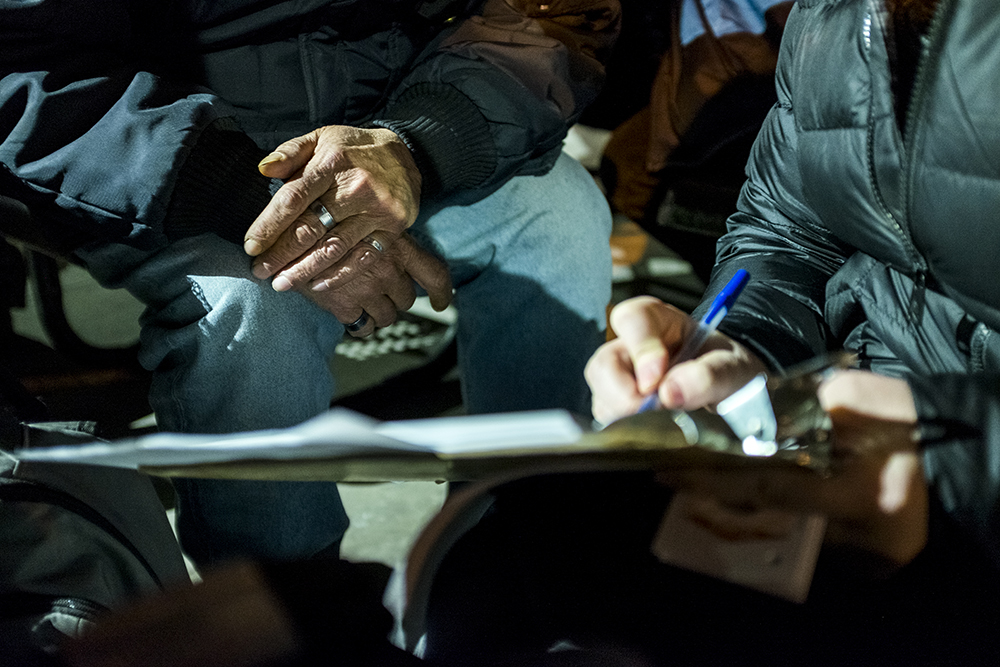Jesse Lyon interviews Richard Martin for the annual point-in-time survey at the Denver Rescue Mission, Jan. 30, 2018. (Kevin J. Beaty/Denverite)  denver; colorado; denverite; kevinjbeaty; homelessness; denver rescue mission; metro denver homeless initiative;