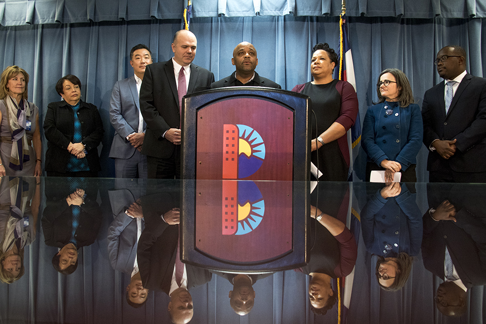 Mayor Michael Hancock speaks at a press conference concerning new leadership for Denver's Department of Public Safety, Feb. 5, 2018. New director Troy Riggs is immediately left of Hancock, while former director Stephanie O'Malley is at right. (Kevin J. Beaty/Denverite)