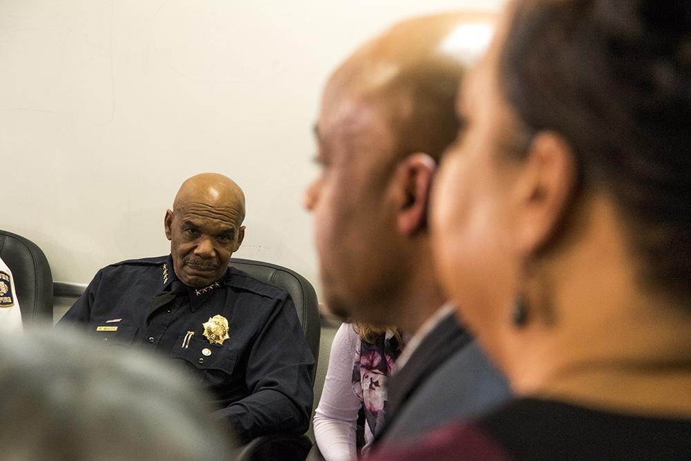 Former Denver Police Chief Robert White listens to Mayor Michael Hancock. (Kevin J. Beaty/Denverite)