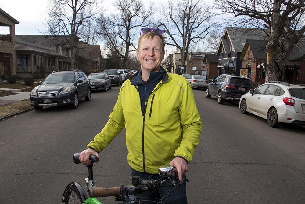 Ben Schumacher and his formidable cargo bike on South Pearl Street, Feb. 6, 2018. (Kevin J. Beaty/Denverite)  platt park; suburbs; denver; colorado; denverite; kevinjbeaty;