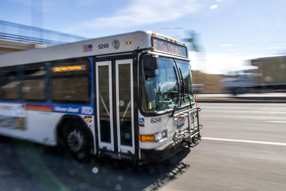 An RTD bus drives through the Colfax Avenue cloverleaf at Federal Boulevard, Feb. 6, 2018. (Kevin J. Beaty/Denverite)