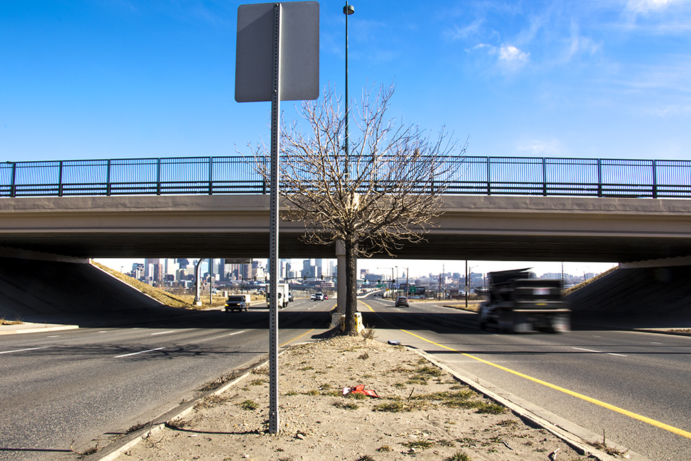 The Colfax Avenue cloverleaf at Federal Boulevard, Feb. 6, 2018. (Kevin J. Beaty/Denverite)   colfax; sun valley; traffic; transportation; kevinjbeaty; denverite; colorado; denver;