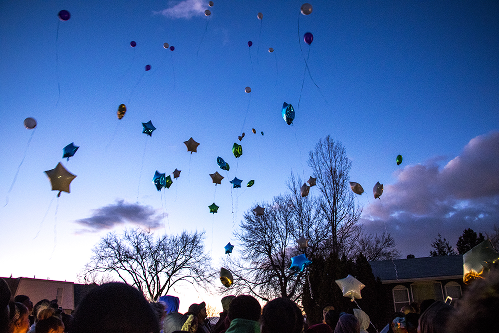 Byron Ware's friends and family release balloons with notes written to him where he was murdered just days prior. Feb. 6, 2018. (Kevin J. Beaty/Denverite)  montbello; crime; gun violence; denver; denverite; kevinjbeaty; colorado; vigil;