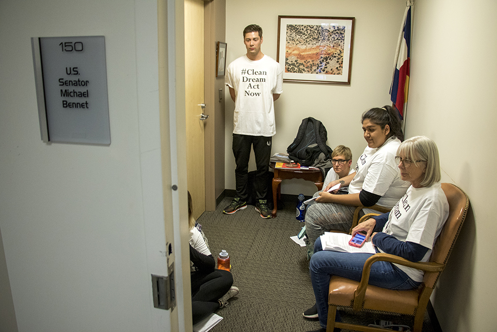 """Patrick Floyd Thibault, center, joins protesters occupying Sen. Michael Bennet's office demanding a """"clean dream act"""" to pass the U.S. Senate, Feb. 7, 2018. (Kevin J. Beaty/Denverite)"""