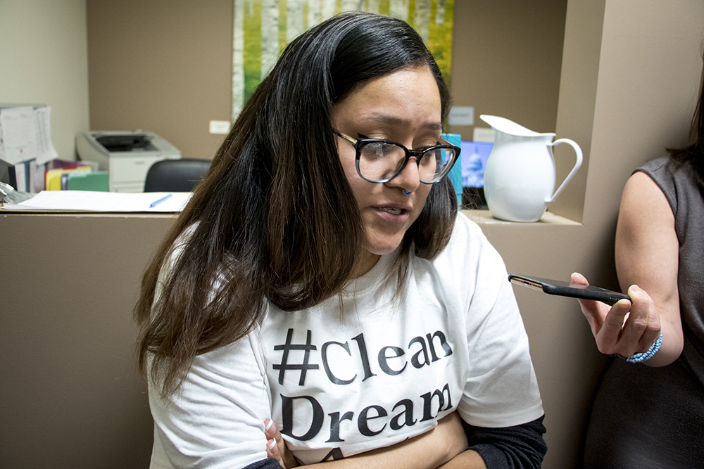 "Pamela Reséndiz speaks with Sen. Michael Bennet as she and five others occupy his office, demanding a ""clean dream act"" to pass the U.S. Senate, Feb. 7, 2018. (Kevin J. Beaty/Denverite)  immigration; denver; colorado; denverite; daca; dream act; senator michael bennet; kevinjbeaty;"