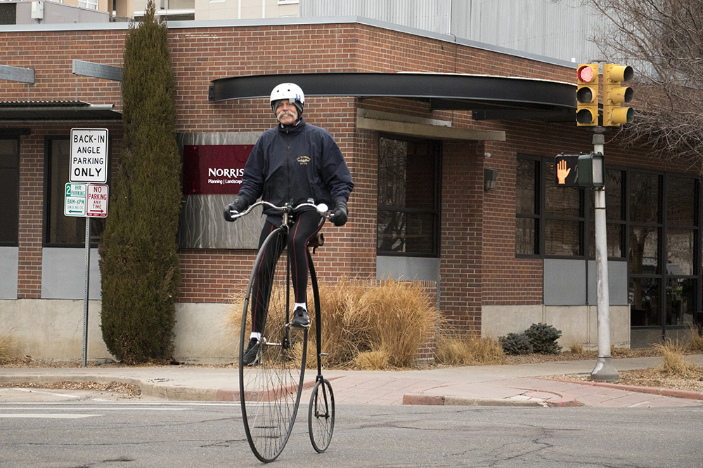 Paul Brekus and his penny-farthing bicycle and vintage moustache on Winter Bike to Work Day, Feb. 9, 2018. (Kevin J. Beaty/Denverite)