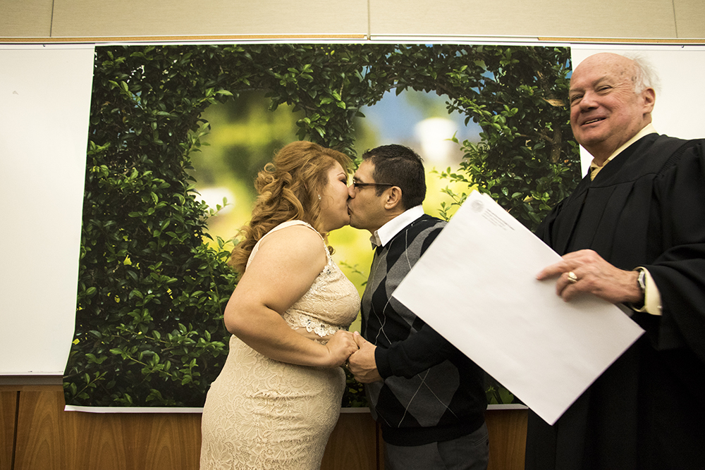 Arturo Gonzalez Munetones and Jackeline Morales Borjas tie the knot on Valentine's Day at the Wellington E. Webb Municipal Office Building, Feb. 14, 2018. (Kevin J. Beaty/Denverite)