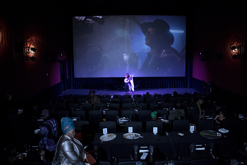 Quincy Shannon ans 9-year-old Shamar welcome the crowd. Black Panther opens in Denver at Alamo Draft House Cinema on West Colfax, Feb. 16, 2018. (Kevin J. Beaty/Denverite)  movie theater; alamo draft house cinema; black panther; denverite; denver; colorado; kevinjbeaty;