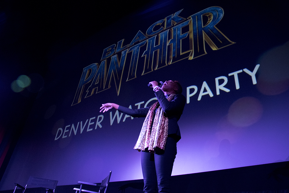 Kerrie Joy performs a slam poem to open the program. Black Panther opens in Denver at Alamo Draft House Cinema on West Colfax, Feb. 16, 2018. (Kevin J. Beaty/Denverite)  movie theater; alamo draft house cinema; black panther; denverite; denver; colorado; kevinjbeaty;