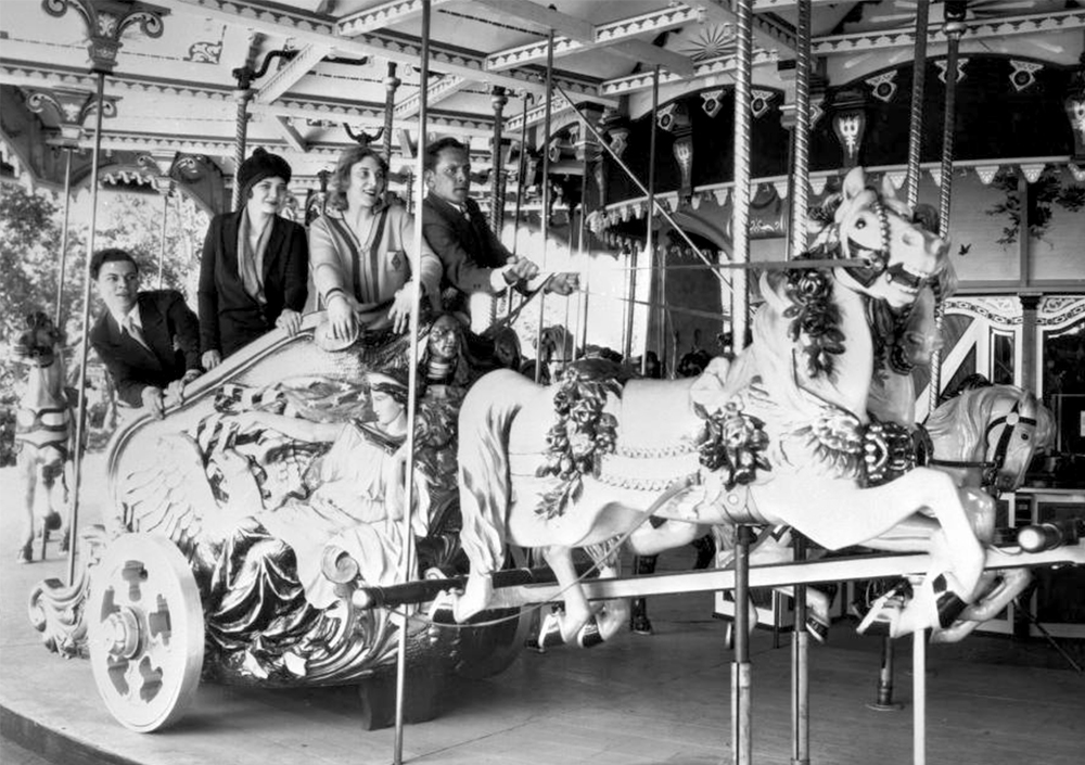 People pose in a merry-go-round chariot at Elitch Gardens, circa 1945. (Denver Public Library/Western History Collection/X-27387)  elitch gardens; amusement park; archival; denver; denverite; kevinjbeaty; colorado;