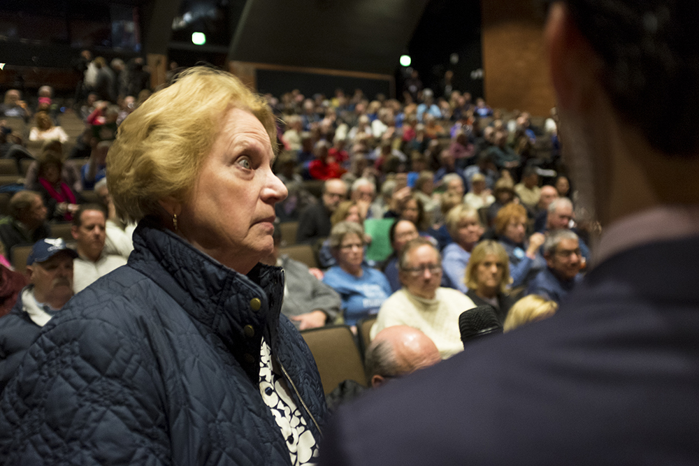 Gail Lavin, who taught here at Cherry Creek High School, grills Mike Coffman on gun violence during his town hall event, Feb. 21, 2018. (Kevin J. Beaty/Denverite)  copolitics; town hall; mike coffman; greenwood village; denver; colorado; denverite; kevinjbeaty;