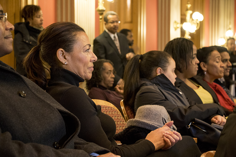 Journalist and documentarian Tamara Banks sits in the crowd as Daddy Bruce Randolph is honored at the Colorado State Capitol, Feb. 20, 2018. (Kevin J. Beaty/Denverite)  denver; colorado; kevinjbeaty; denverite; daddy bruce randolph;