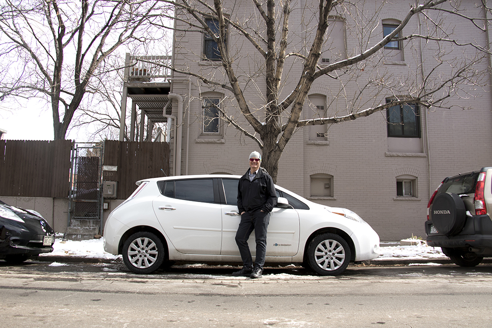 """Energy geek"" Mike Sickinger and his all-electic Nissan Leaf Feb. 23, 2018. (Kevin J. Beaty/Denverite)  denver; denverite; colorado; kevinjbeaty; electric vehicle; ev; transportation; capitol hill;"