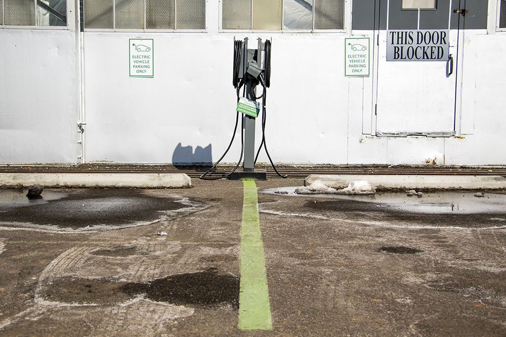 An EV charging station near the Lowry Beer Garden, Feb. 23, 2018. (Kevin J. Beaty/Denverite)